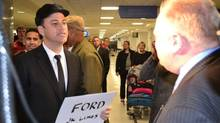 Comedian Jimmy Kimmel, dressed as a limo driver, picks up Toronto Mayor Rob Ford at Los Angeles International Airport on Saturday March 1. (ABC/Jimmy Kimmel Show)