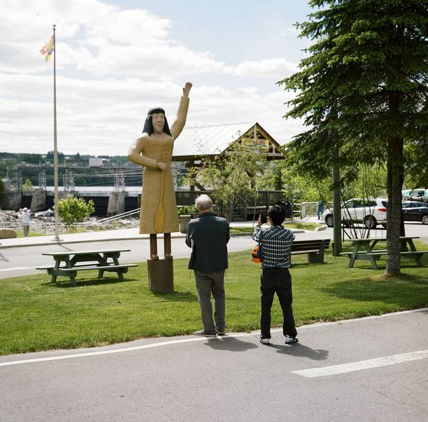 Grand Falls, N.B.: The passengers stop to look at a statue of Malobiannah, a woman remembered in Maliseet legend for sacrificing herself to defeat a party of Mohawk invaders.