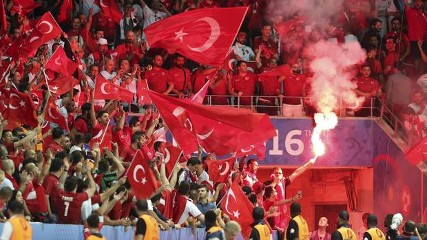 Turkish fans light flares during the Euro 2016 Group D soccer match between Spain and Turkey at the Allianz Riviera stadium in Nice, France, Friday, June 17, 2016.