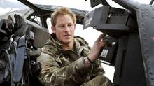 Britain's Prince Harry performs a pre-flight check on his Apache Helicopter after starting his 12 hour VHR (very high ready-ness) shift at the British controlled flight-line in Camp Bastion, southern Afghanistan in this photograph taken on November 1, 2012, and released on January 21, 2013. (POOL/REUTERS)