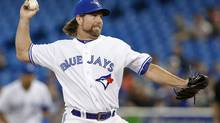Toronto Blue Jays R.A. Dickey pitches to the New York Yankees during the first inning of their MLB American League baseball game in Toronto, September 17, 2013. (MARK BLINCH/REUTERS)