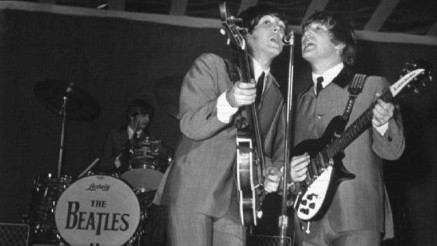 Beatles singers Paul McCartney and John Lennon play at Empire Stadium in Vancouver on August 22, 1964. After a mere 27 minutes, police cut the show short because they feared the 20,261 screaming fans were going to rush the stage and riot. (George Diack/The Canadian Press/Vancouver Sun)