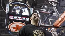 Rapper Drake stands on the court at the end of the first quarter as Toronto Raptors take on Brooklyn Nets in NBA basketball action in Toronto on Saturday January 11 , 2014. (Chris Young/THE CANADIAN PRESS)