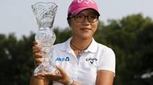 Lydia Ko, of New Zealand, holds up her trophy after winning the Marathon Classic LPGA golf tournament at Highland Meadows Golf Club in Sylvania, Ohio, Sunday, July 20, 2014. (Rick Osentoski/AP)