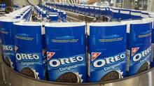 Packages of Oreo cookies snake along a producution line at a Kraft Canada plant in Montreal on Feb. 29, 2012, (Ryan Remiorz/Ryan Remiorz/The Canadian Press)
