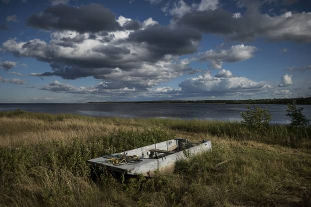 A dilapidated scow, once used for fishing, sits in a field in Kouchibouguac National Park near the site where Jackie Vautour and his wife, Yvonne, were arrested for illegally fishing shellfish.