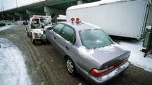 Proposed legislation in Ontario would compel tow-truck operators to publicly post their prices and provide itemized invoices. (FRED LUM/THE GLOBE AND MAIL)