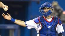 Toronto Blue Jays catcher J.P Arencibia takes the ball from the umpire, behind home plate in the sixth inning of their American League MLB baseball game against the Detroit Tigers in Toronto July 4, 2013. (Reuters)