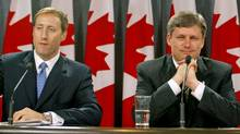 Progressive Conservative leader Peter MacKay and Canadian Alliance chief Stephen Harper announce a merger deal between their two parties at an Ottawa news conference on Oct 16, 2003. (TOM HANSON/The Canadian Press)