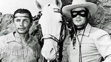 Actors Jay Silverheels, left, as Tonto, and Clayton Moore in the title role of The Lone Ranger television series in 1951. The Walt Disney Co. has pulled the plug on the The Lone Ranger' starring Johnny Depp as Tonto and Armie Hammer as the masked man. (AP)