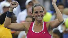 Roberta Vinci of Italy celebrates after defeating Agnieszka Radwanska of Poland in their women's singles match at the U.S. Open tennis tournament in New York September 3, 2012. (RAY STUBBLEBINE/REUTERS)