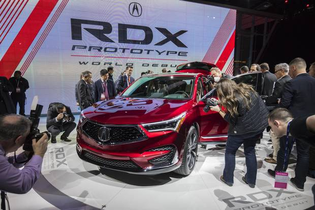 Members of the media get their first close-up look at the 2019 Acura RDX Prototype at the 2018 North American International Auto Show in Detroit on Jan. 15, 2018.