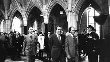 U.S. President Richard Nixon tours the halls of Parliament with Prime Minister Pierre Trudeau on April 14, 1972. (John McNeill)