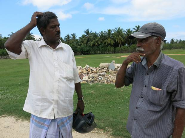 The first two men in Atchuvely who offered us help in finding my dad's house.