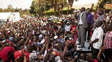 Supporters of Kenyan presidential candidate Uhuru Kenyatta celebrate outside his home after hearing news that he won the presidential election, near Nairobi, Kenya, March 9, 2013. (PETE MULLER/NYT)
