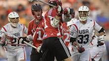 Canada midfielder Kevin Crowley (21) scores in the first half against the United States at the FIL World Lacrosse Championship game Saturday, July 19, 2014. Crowley scored five times and led Canada to win the world title. (Karl Gehring/AP)