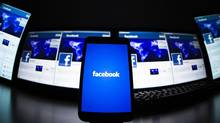 The loading screen of the Facebook application on a mobile phone is seen in this photo illustration file photo taken in Lavigny May 16, 2012. (VALENTIN FLAURAUD/REUTERS)