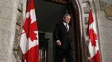 Canada's Prime Minister Stephen Harper arrives to deliver a statement on the situation in Libya in the foyer of the House of Commons on Parliament Hill in Ottawa February 25, 2011. (CHRIS WATTIE/REUTERS/CHRIS WATTIE/REUTERS)