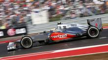 McLaren Formula One driver Lewis Hamilton of Britain drives during the U.S. F1 Grand Prix at the Circuit of the Americas in Austin, Texas November 18, 2012. (JIM YOUNG/REUTERS)