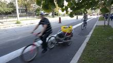 Cyclists use bicycle lanes on Sherbourne St. in Toronto. (2012 File photo) (Kevin Van Paassen/The Globe and Mail)