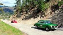 Ted Laturnus, in his 1976 Taiga green BMW 2002, leads a pair of Porsche 356s during the Spring Thaw Rally in British Columbia. Credit: Warrick Patterson/Classic Car Adventures