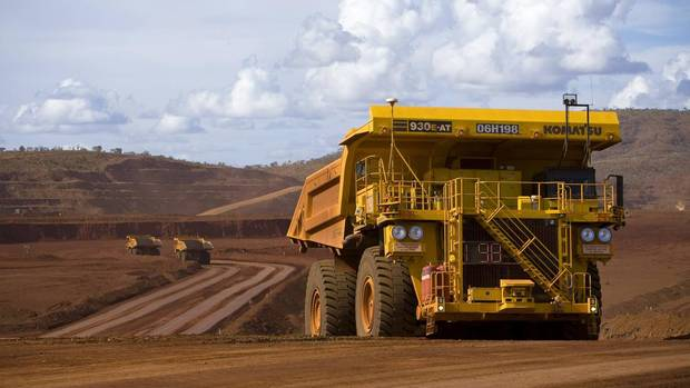 FEB. 14: RIO TINTO. The miner is expected to report a 49-per-cent plunge in second-half profit to $3.93-billion (U.S.); analysts also expect more details on Rio's stated goal of $5-billion in cost cuts by the end of 2014. (In photo: Remotely controlled tipper trucks operate at a Rio Tinto iron ore mine in Western Australia.) (HANDOUT/REUTERS)
