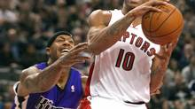 Toronto Raptors' DeMar Derozan drives to the basket past Sacramento Kings' James Johnson (L), who fouls him in the process, in the first half of their NBA game in Toronto January 4, 2013. (FRED THORNHILL/REUTERS)