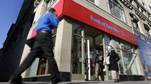 In this Monday, Jan. 7, 2013 file photo, people pass a Bank of America branch in New York. (Richard Drew/AP)