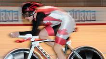 Canada's Tara Whitten races in the individual pursuit event of the women's omnium at the Track Cycling World Championships in Melbourne, Australia, Saturday, April 7, 2012. (Andrew Brownbill/AP)