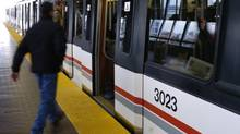 Commuters board the TTC'c Scarborough RT at Kennedy Station. (Louie Palu/The Globe and Mail)