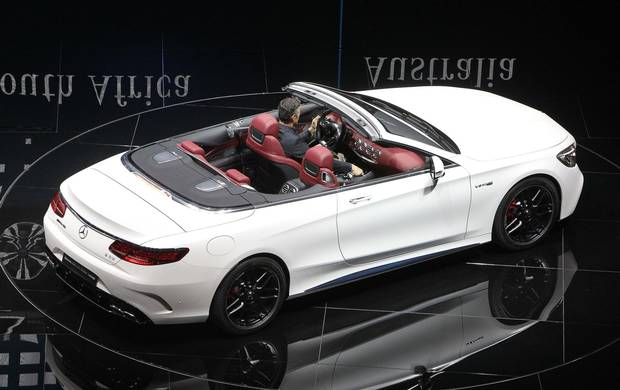 A Mercedes S Cabriolet is presented on stage at the Frankfurt Motor Show IAA in Frankfurt am Main, western Germany, on September 12, 2017. According to organisers, around 1,000 exhibitors from 39 countries will showcase their products and services. This year's fair running from September 14 to 24, 2017 will focus on digitization, urban mobility and electric mobility.