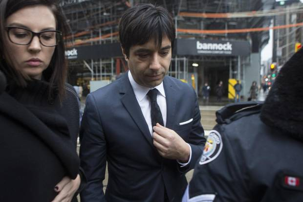 Jian Ghomeshi arrives at a Toronto courthouse on March 24, 2016, for the verdict in his trial.