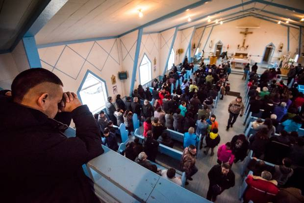Sunday worshippers pray for the victims of Friday's mass shooting in La Loche, Sask.