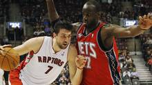 Toronto Raptors' Andrea Bargnani goes to the basket against New Jersey Nets' Johan Petro (R) during the first half of their NBA basketball game in Toronto, January 6, 2012. REUTERS/Mark Blinch (Mark Blinch/Reuters)