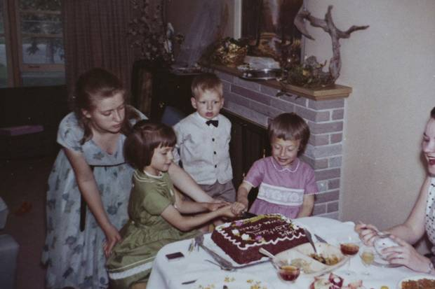 A childhood photo shows Rosanne and Theresa Luckevich – in green and pink dresses, respectively – celebrating their shared birthday.