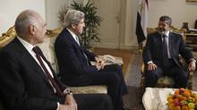 Egypt's President Mohamed Mursi (R) and Foreign Minister Mohamed Kamel Amr meet U.S. Secretary of State John Kerry (C) at the presidential palace in Cairo March 3, 2013. Kerry said on Saturday it is vital that Egypt revive its economy and that the country's fractious political parties reach agreement on painful economic reforms to secure an IMF loan. (AMR ABDALLAH DALSH/REUTERS)