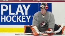 Canada's goalie Tyler Bunz stretches during Canada's annual selection camp in preparation for the upcoming IIHF World Junior Championships in Calgary, Alta., on Sunday, Dec. 11, 2011. (Nathan Denette/THE CANADIAN PRESS)