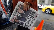 A television reporter holds a copy of the New York Post as she works outside Manhattan Criminal Court, where International Monetary Fund (IMF) chief Dominique Strauss-Kahn's arraignment is being held, in New York City May 16, 2011. Strauss-Kahn was denied bail on Monday on attempted rape and other criminal charges, and prosecutors said they are investigating whether he may have engaged in similar conduct once before. (Mike Segar/Reuters)