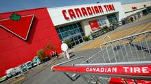 Customers head in and out of a Canadian Tire store location in Scarborough, Ont.