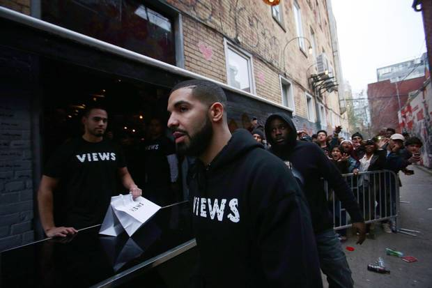 Toronto rapper Drake leaves a Queen St. West pop up shop where he was handing out T-shirts to promote his upcoming album in Toronto in this April 24, 2016, file photo.