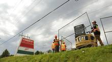 Steel fencing is erected around the Algo Centre Mall in Elliot Lake, Ont., on Wednesday. (Fred Lum/The Globe and Mail)