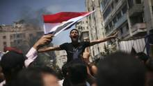 An Egyptian protester chants slogans against presidential candidate Ahmed Safiq during a demonstration against the Supreme Constitutional Court rulings in Alexandria, Egypt, June 15, 2012. (Manu Brabo/AP)