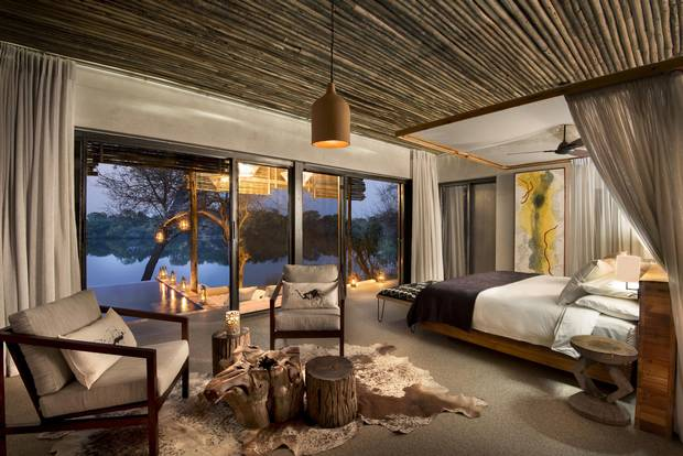 Matetsi's lodge is set at the riverbank, providing the only source of light for miles.