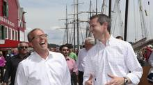 Saskatchewan Premier Brad Wall, left, and Ontario Premier Dalton McGuinty share a laugh in Lunenburg, Nova Scotia, July 25, 2012. (REUTERS)