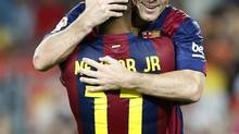 Barcelona's Neymar (L) celebrates his second goal with Lionel Messi against Mexico's Club Leon during their Joan Gamper Trophy soccer match at Nou Camp stadium in Barcelona August 18, 2014. (GUSTAU NACARINO/REUTERS)