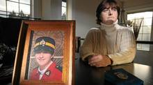A framed photo of recently graduate RCMP Constable Janet Merlo in August, 1991, seen here at her home in Nanaimo,BC, left the force in 2010 after years of dealing with sexual harassment issues that the force ignored. (Chad Hipolito/Chad Hipolito For The Globe and Mail)