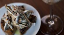 Although it looks cramped, the restaurant is actually quite comfortable. Marinated white anchovies on toast with a flight of dry sherry is seen at Espana restaurant in Vancouver, British Columbia, Wednesday, November 21, 2012. Rafal Gerszak for The Globe and Mail (Rafal Gerszak For the Globe and Mail)