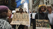 Members of the Occupy Wall Street movement take part in a protest march through the financial district of New York Oct. 12, 2011. (LUCAS JACKSON/REUTERS)