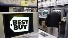 File photo of patrons looking at television sets at a Best Buy outlet in Montreal. (Christinne Muschi/The Globe and Mail)