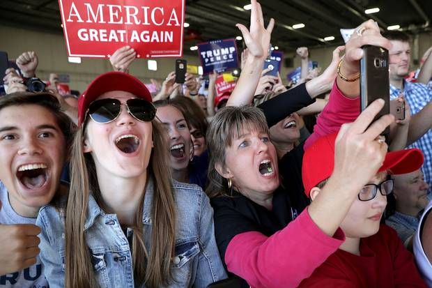 Supporters cheer for Donald Trump during a campaign rally in the Sun Country Airlines Hangar at Minneapolis-Saint Paul International Airport on Nov. 6, 2016.